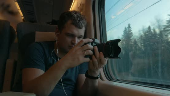 Thumbnail for Man Stocker in Train Listening To Music and Making Footage