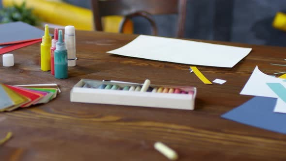 Thumbnail for Desk with Art Supplies Left on It