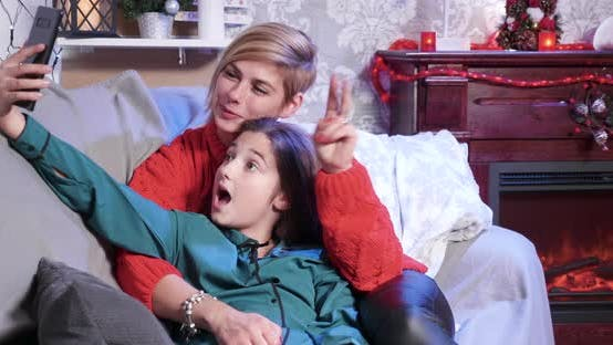 Thumbnail for Happy Mother and Daughter Making Selfie on Christmas Day