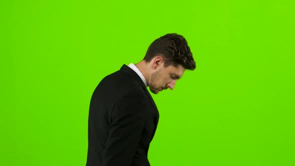 Thumbnail for Man Is Going To a Business Meeting and Waving Greetings. Green Screen. Back View