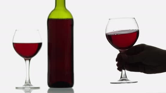 Thumbnail for Glass with Rose Wine. Wine Glasses with Red Wine Against White Background