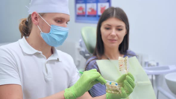 Dentist Doctor with Patient at Consultation