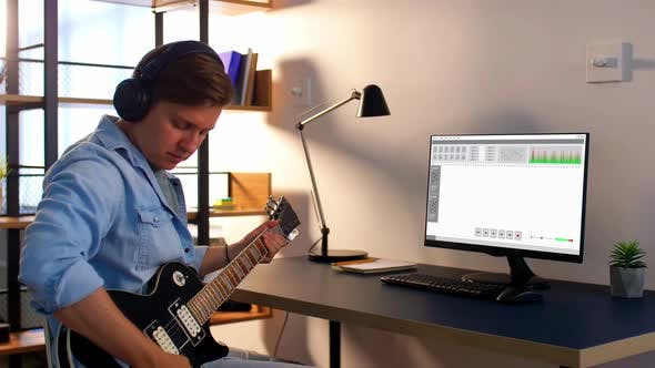 Thumbnail for Man Playing Guitar and Recording Music at Home