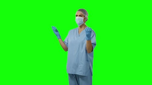 Young surgeon in scrubs