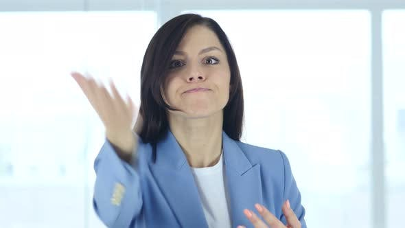 Thumbnail for Portrait of Angry Young Businesswoman Yelling toward Camera