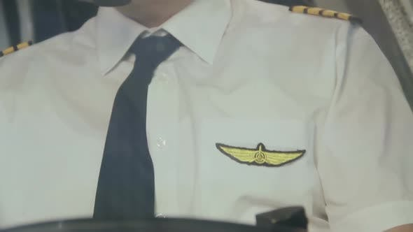 Thumbnail for Pilot's Insignia on Uniform, Captain Controlling Airliner, Thinking About Home