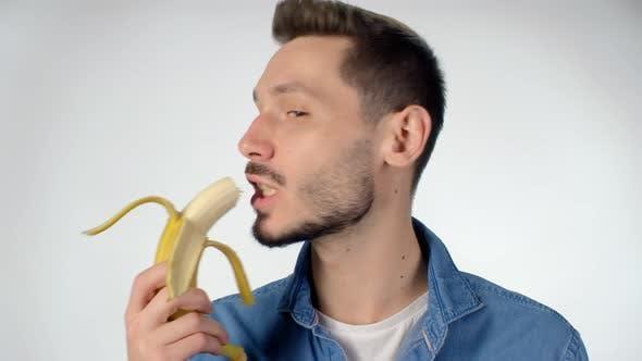 Thumbnail for Bearded Man Eating Banana