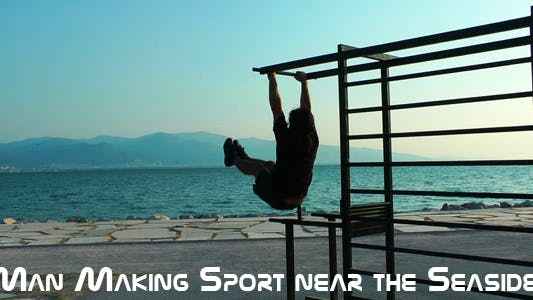 Thumbnail for Man Making Sport Near The Seaside