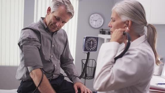 Thumbnail for Professional doctor measuring senior man's blood pressure
