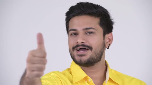 Thumbnail for Young Happy Bearded Indian Businessman Giving Thumbs Up