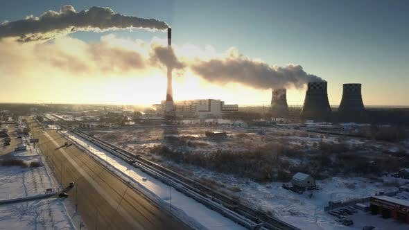Thumbnail for Morning Sun Shines From Behind Power Station in Winter