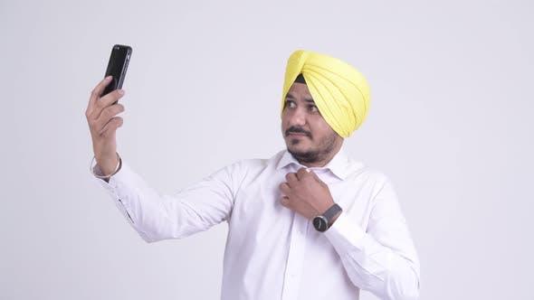 Thumbnail for Happy Bearded Indian Sikh Businessman Taking Selfie