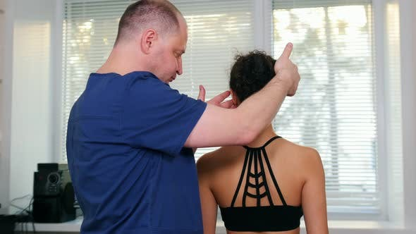 Thumbnail for Doctor Working with Young Woman's Neck To the Sides