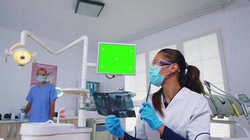 Dentist Doctor Showing Unit Monitor with Mockup Screen Pov Patient