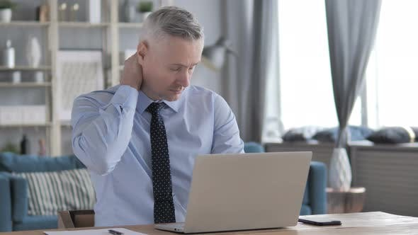 Thumbnail for Tired Gray Hair Businessman with Neck Pain Working on Laptop