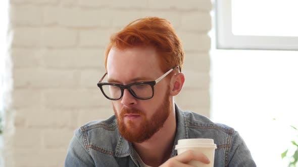 Thumbnail for Man w/ Beard, Red Hairs Drinking Coffee, Tea in Office, Portrait