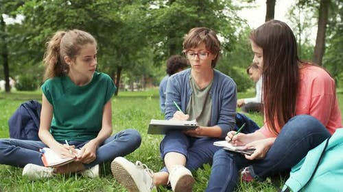 Two Schoolgirls with Teacher on Outdoor Lesson