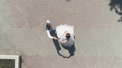 Top down aerial view of wedding couple dancing in a park 25