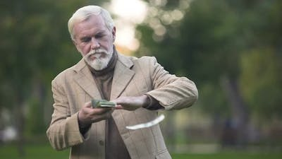 Handsome Aged Man Throwing Around Dollar Bills, Wealth Happiness, Lottery Luck