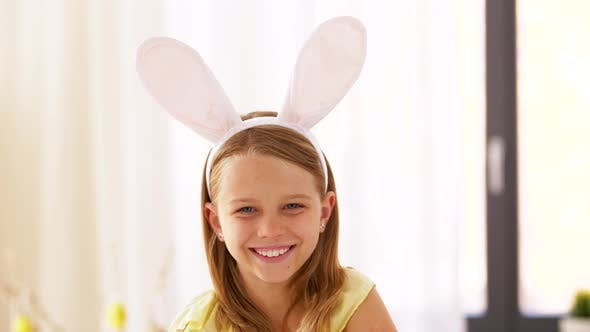 Happy Girl Wearing Easter Bunny Ears Headband