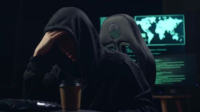 Asian Male Hacker Using Computer Hacking And Upset