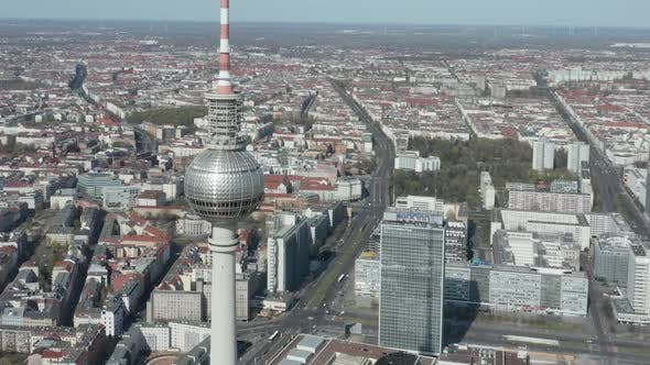 Thumbnail for AERIAL: Close View of Alexanderplatz TV Tower in Empty Berlin, Germany with No People or Cars on