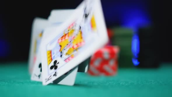 Classic Playing Poker Cards Are Falling on Green Felt Background