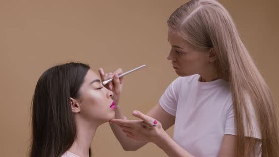 Thumbnail for Professional Make Up Artist Making Ceremonial Makeup for Beautiful Asian Lady