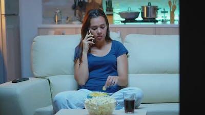 Woman in Pajamas Talking at Phone