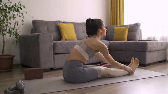 Thumbnail for Healthy Flexible Girl Stretching Legs and Relaxing Muscles After Yoga Practice at Home