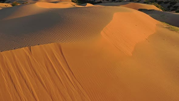 Thumbnail for Aerial Top View on Sand Dunes in Desert at Sunrise