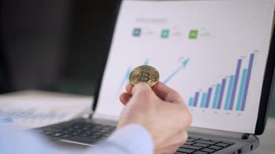 Bitcoin in the hands of a businessman. Symbol of cryptocurrency