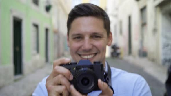 Thumbnail for Happy Cheerful Young Man Taking Pictures