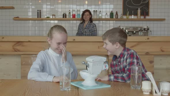 Thumbnail for Happy Kids Laughing Playing Toy at Cafeteria Table