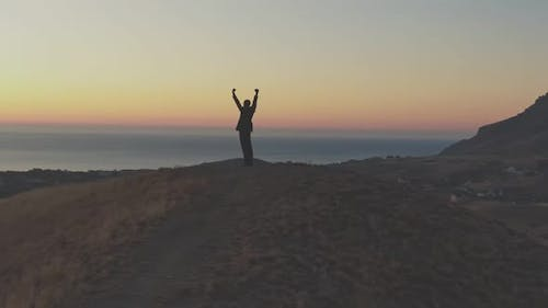 The Concept of Hope Man in the Suite Meets Dawn on Top of the Hill Actions of the Man Courageous and