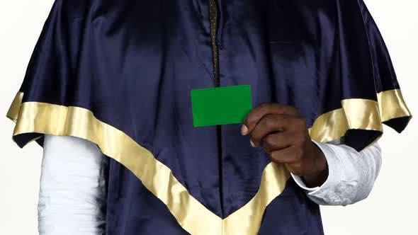 Thumbnail for Student Holding a Green Card and Shows the Thumb. White. Close Up