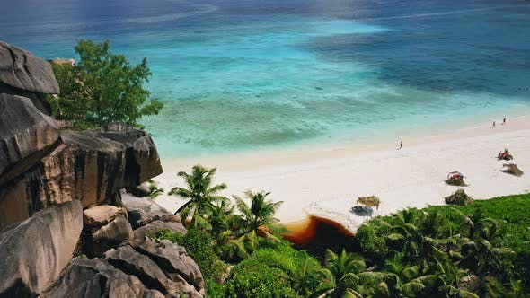 Thumbnail for Aerial Ocean Reveal Footage of Grand Anse Beach. Crystal Clear Turquoise Blue Ocean Lagoon. La Digue