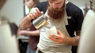 Barista Making Coffee in Coffeeshop