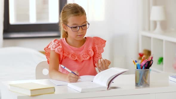 Thumbnail for Student Girl with Book Writing To Notebook at Home