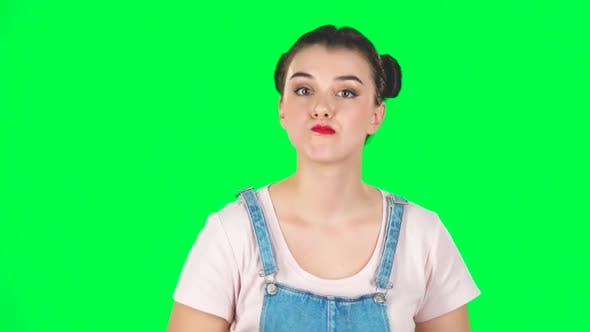 Thumbnail for Young Woman Stands Waiting with Boredom on Green Screen. Slow Motion
