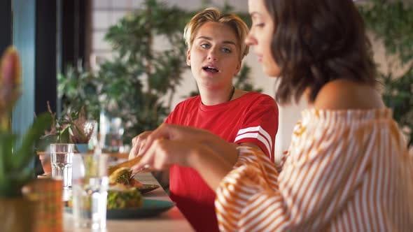 Thumbnail for Female Friends Eating at Restaurant