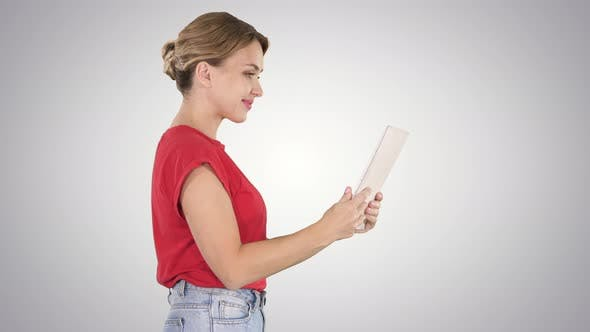 Thumbnail for Woman in Casual Clothing Using Digital Tablet Walking on Gradient Background