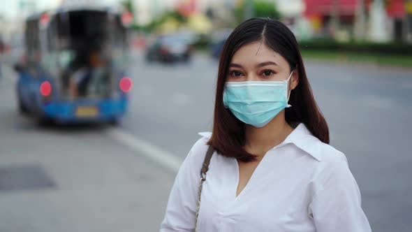 woman in city street and wearing face mask protective for spreading of coronavirus pandemic