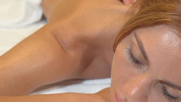 Cover Image for Sliding Cropped Shot of a Woman Resting at Spa Getting Massage