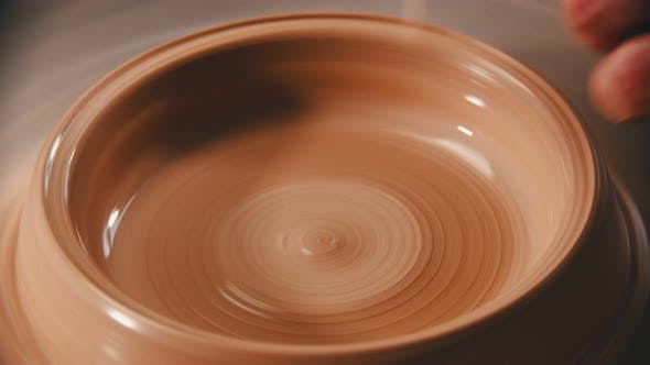 Thumbnail for Pottery - the Master Is Dripping Water Into a Clay Bowl and Spining