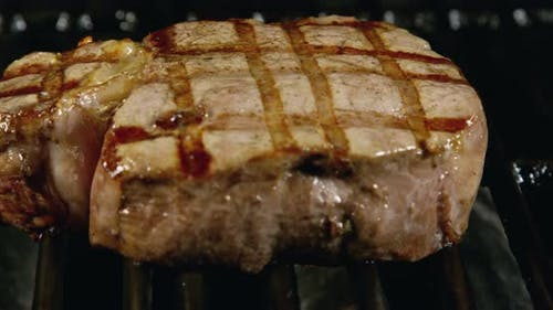 Filet Mignon Steak Over grill Charcoal With Marks 24b