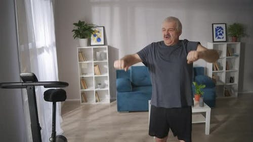Middleaged Man with Vertebral Pain Is Doing Gymnastics at Home Curing and Prevention of Spinal