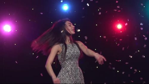 Brunette Woman Dancing in Front Disco Style Lights. Slow Motion