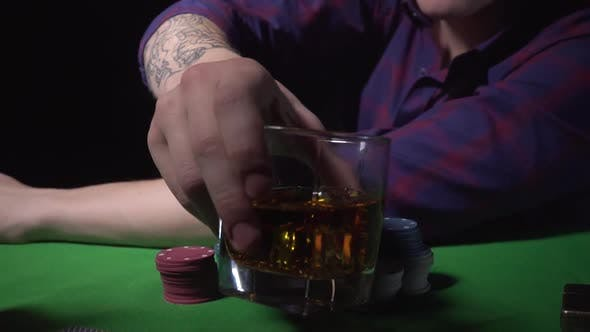 Thumbnail for Guy Drinks Whiskey at the Casino