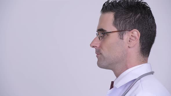 Thumbnail for Head Shot Profile View of Handsome Man Doctor Wearing Eyeglasses